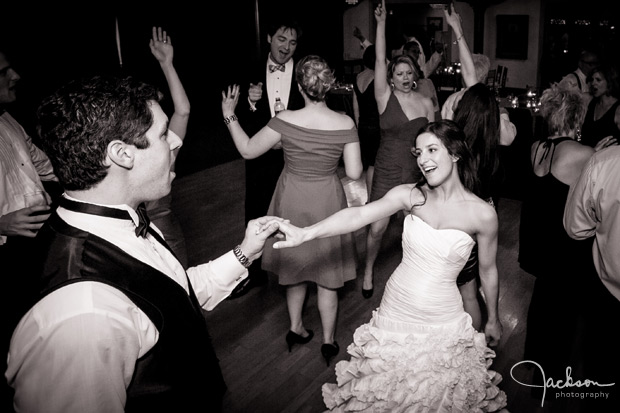 bride and groom getting down dancing
