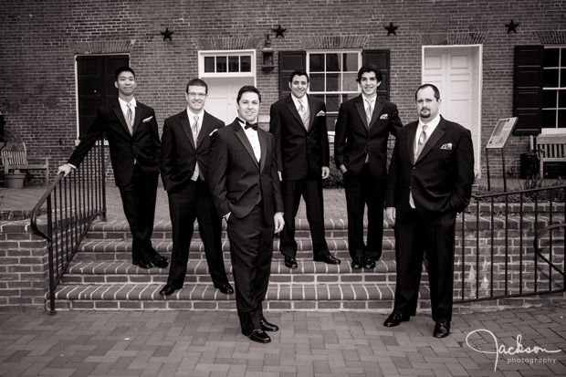 groom and groomsmen on brick steps