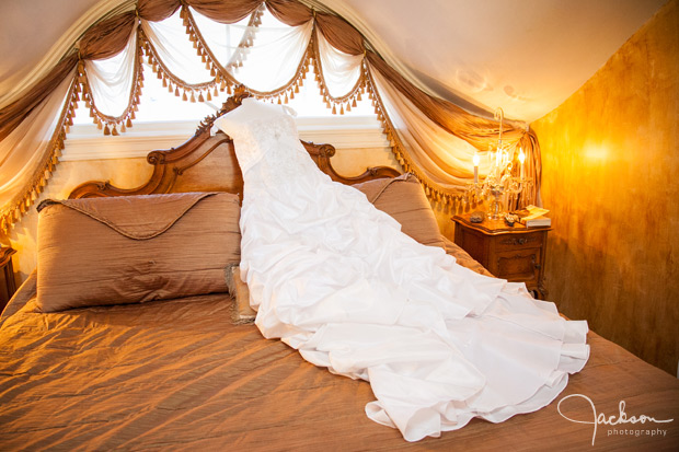 bride's dress laying on bed