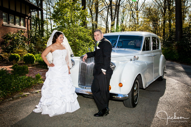 bride and groom in front of rolls royce