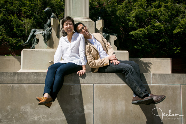 couple sitting in front of sculpture