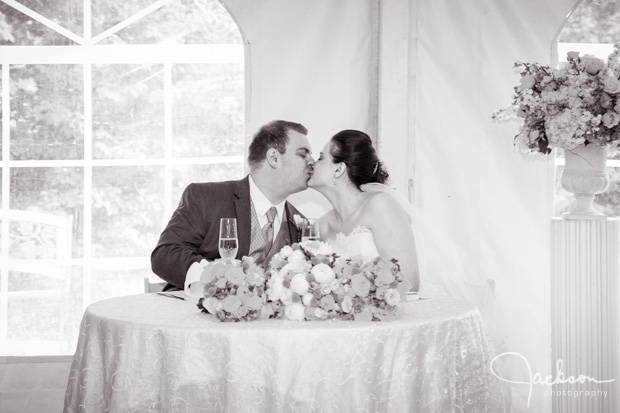 bride and groom kissing at toast