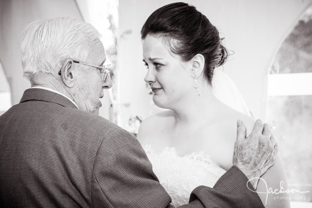 bride crying with grandfather