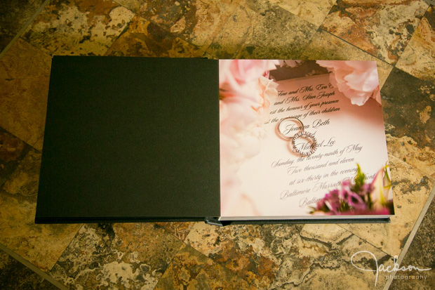 opening album page with rings and flowers
