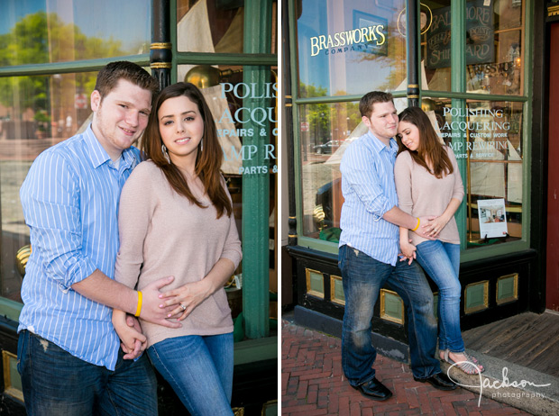 couple posing at reflective storefront window