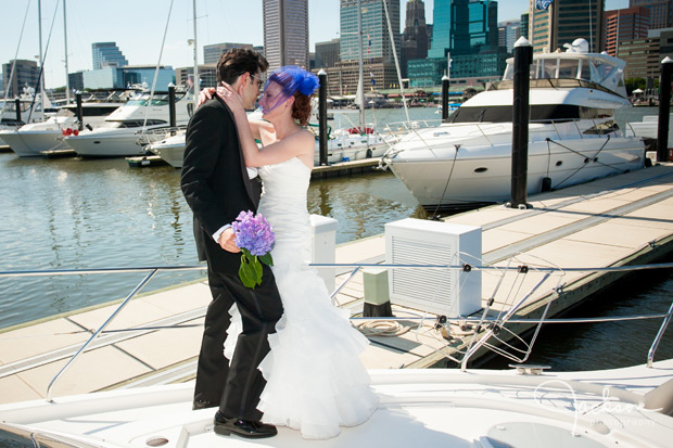bride and groom embracing on boat