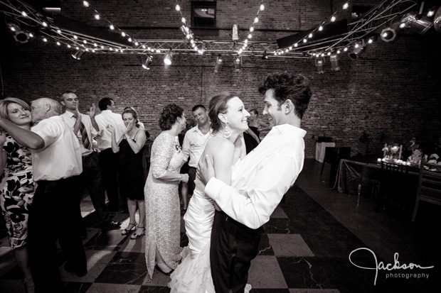 bride and groom dancing black and white