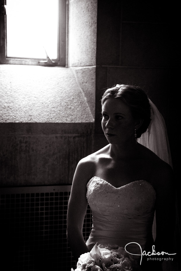 bride lit by window of loyola chapel