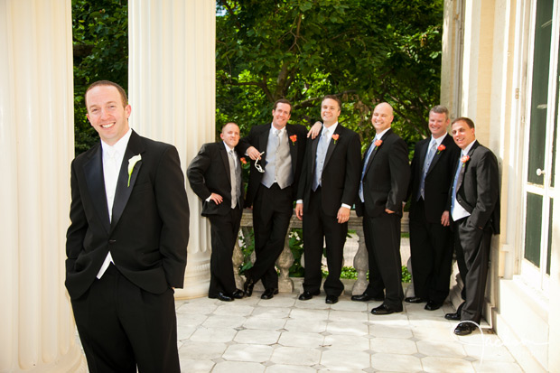 groom and groomsmen on the steps of evergreen