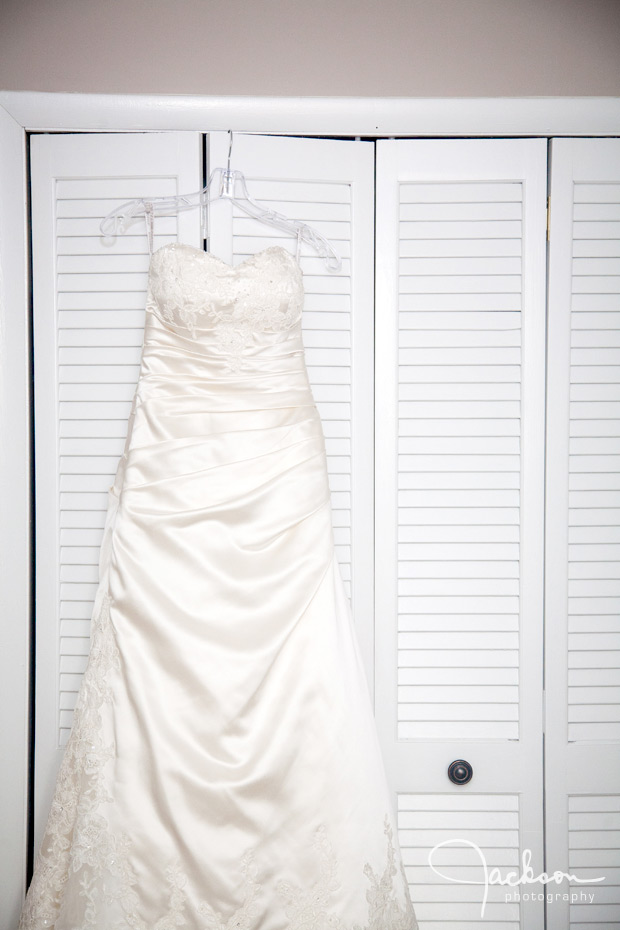 bride's gown hanging on closet