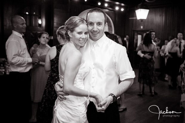 bride and groom dancing in carriage house