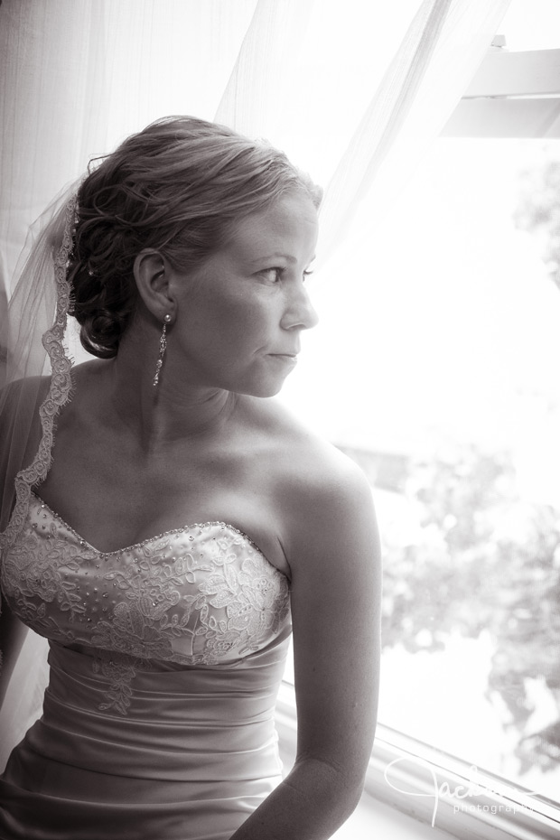 bride by house window