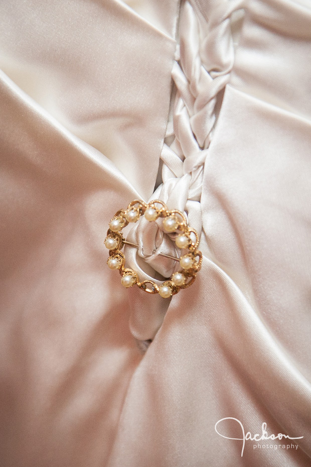 brooch on brides dress