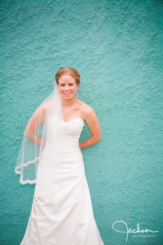bride on aqua stucco wall