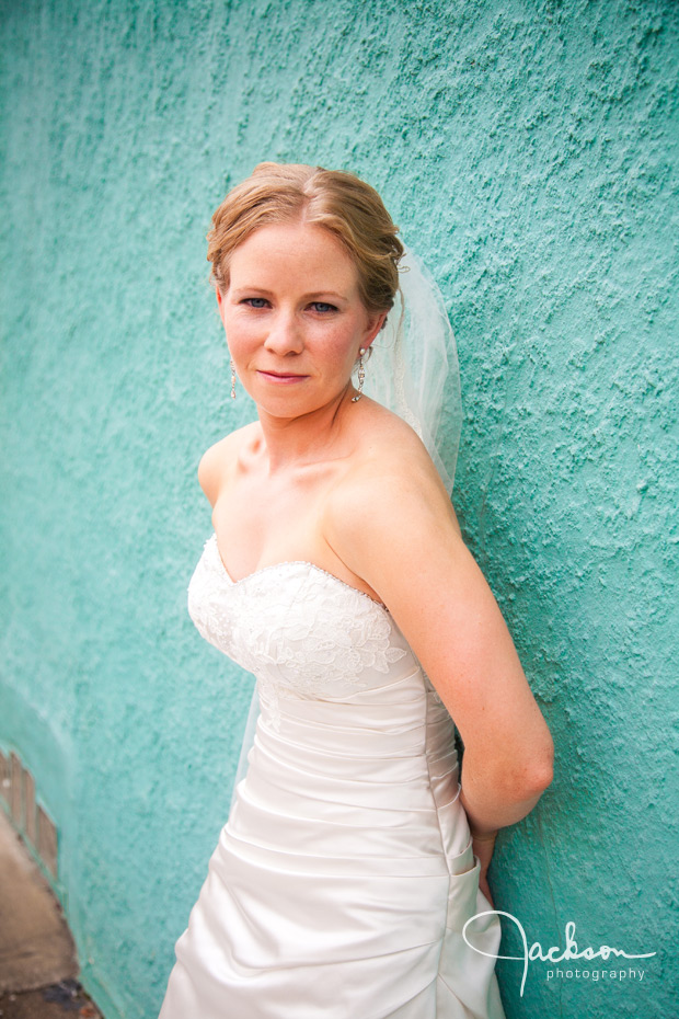 bride on blue stucco wall