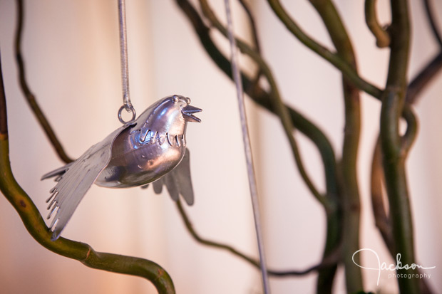 metal bird hanging from ceremony tree