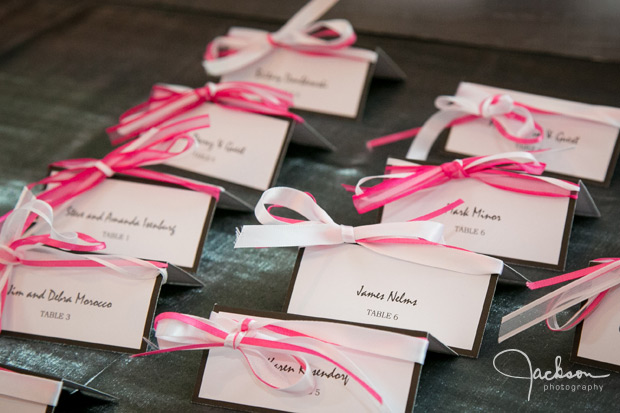pink and white ribbon namecards