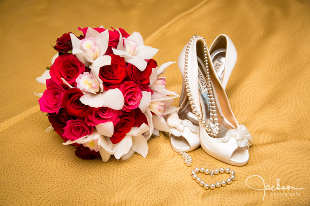 red and white orchid bouquet with pearls and shoes