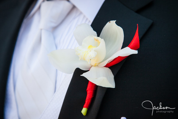 white and red orchid boutonniere