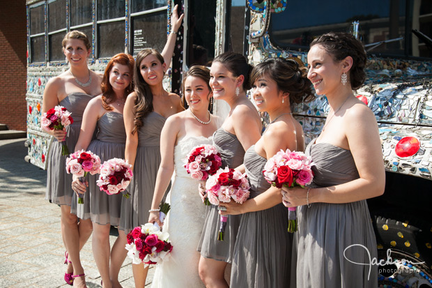 bridesmaids with grey dresses red and white bouquets