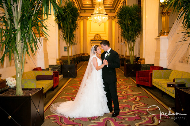 bride and groom in grand lobby of hotel monaco