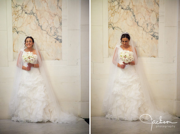 bride posing in front of marble