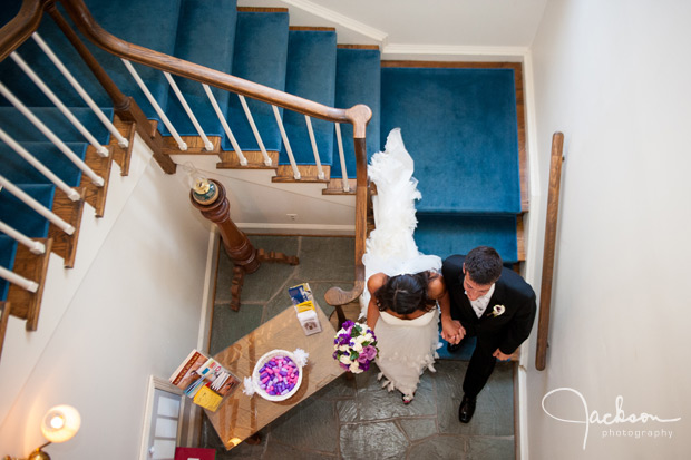 bride and groom going down the stairs from above