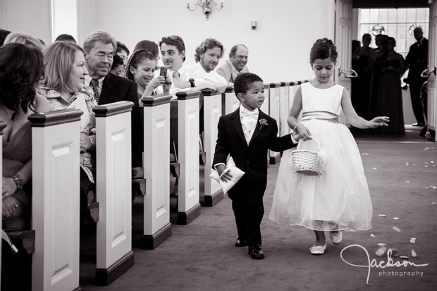 ring bearer and flower girl walking down the aisle