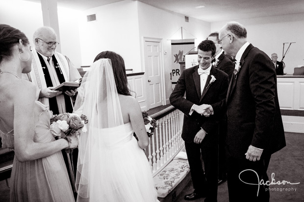 groom shaking dads hand at altar