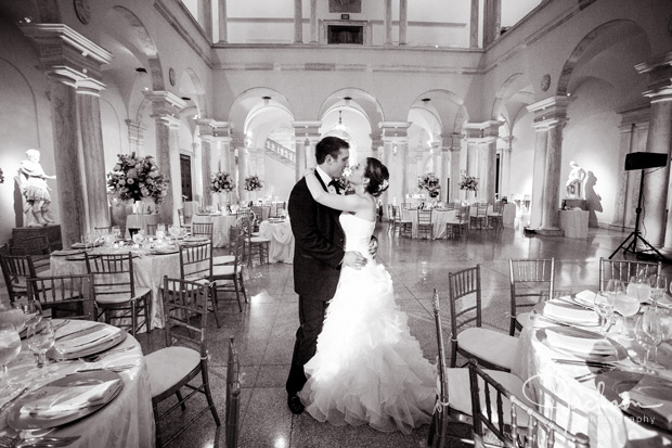 bride and groom among reception tables