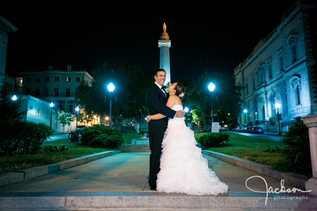 bride and groom at night in mount vernon square
