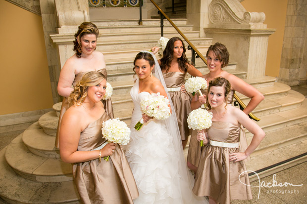 bride with bridesmaids in gold and white