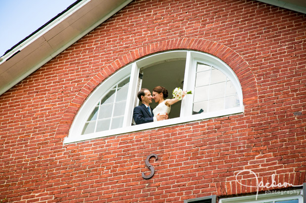 bride and groom in upstairs open window