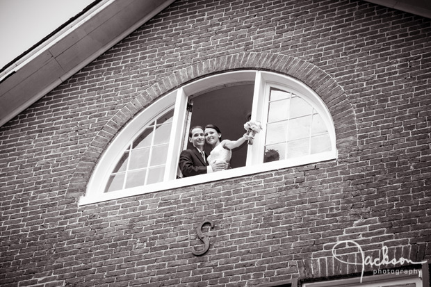 bride and groom embracing in window