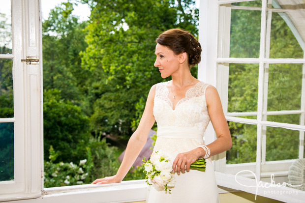 bride looking out suite window