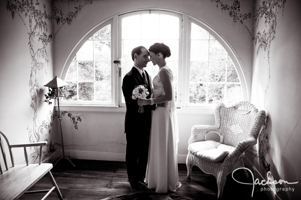 bride and groom by upstairs garden window