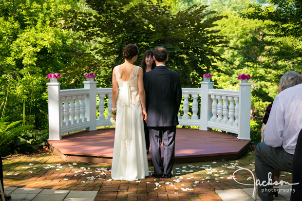 bride and groom at garden altar