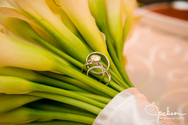 wedding rings among stems of bride bouquet