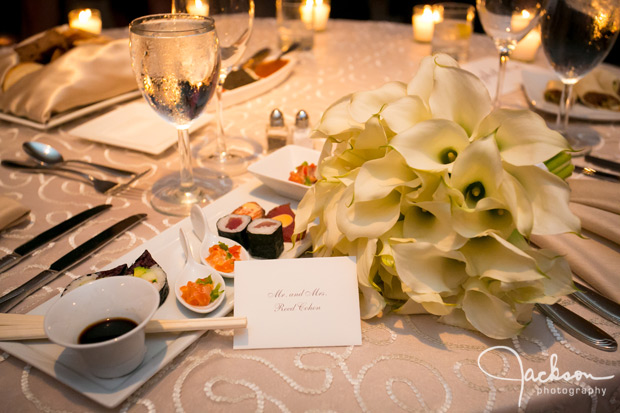 flowers and sushi on bridal table