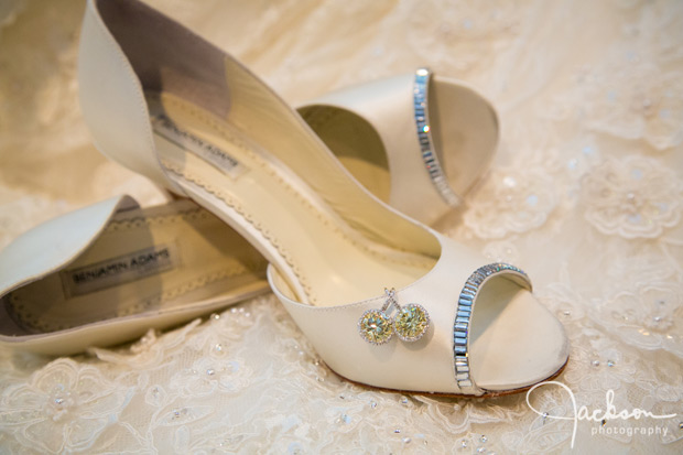 bride's cream colored heels and diamond earrings