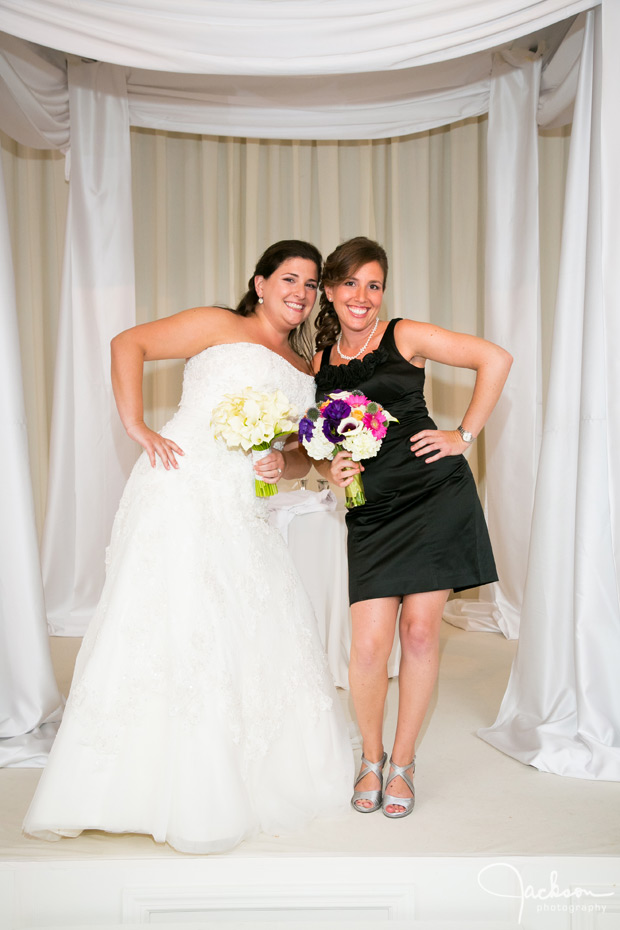 bride and maid of honor in black bridesmaid dress