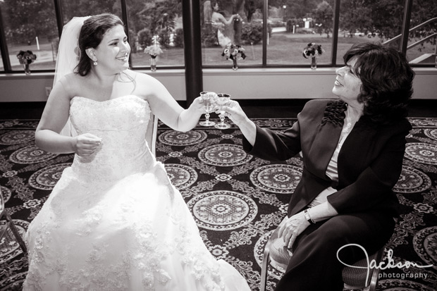 bride and mother toasting scotch