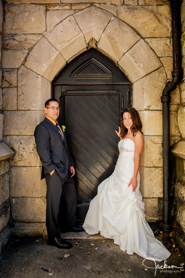 bride and groom in stone doorway