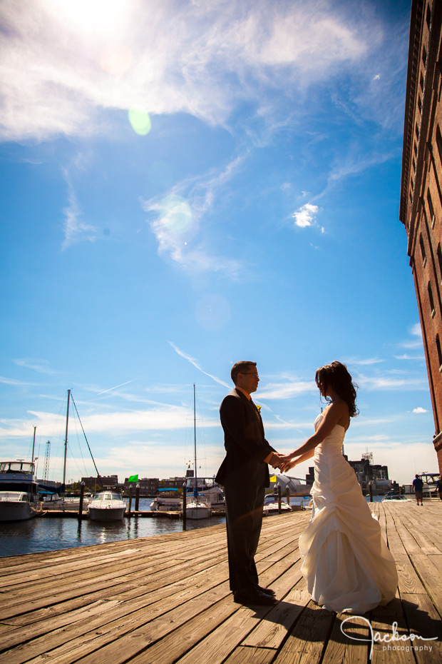 bride and groom at fells point pier