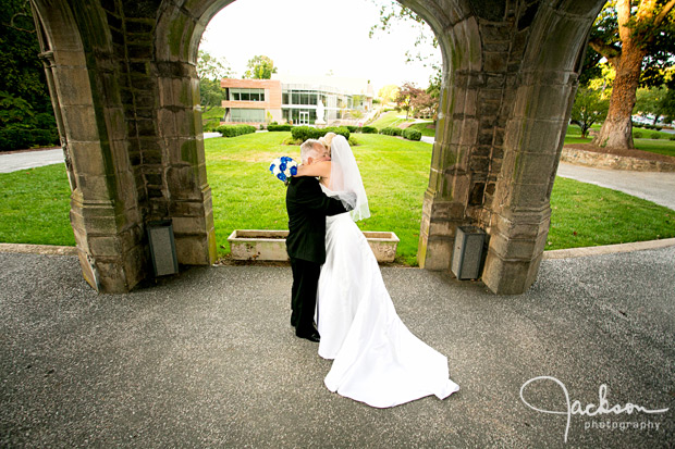 bride and groom embracing in front of maryvale castle