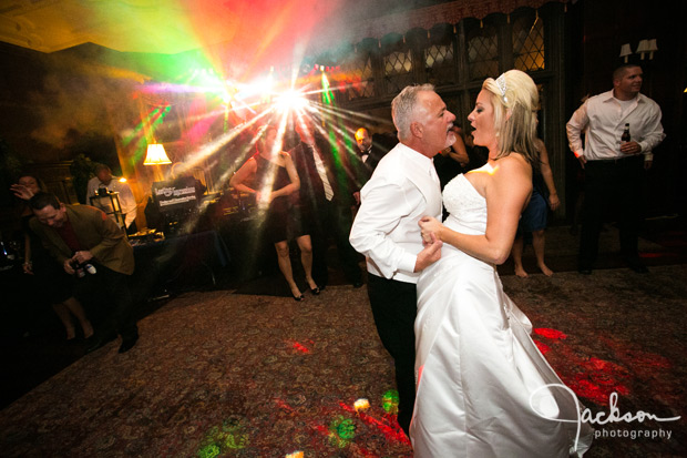 bride and groom dancing with colored lights