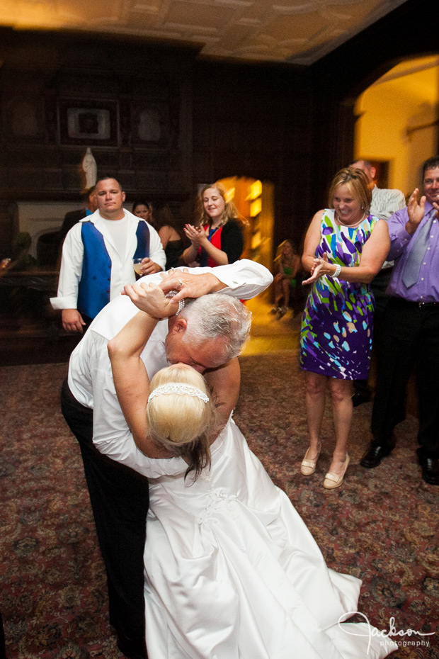 groom dipping bride on dancefloor