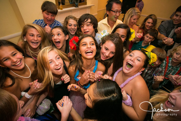 mitzvah girl surrounded by friends at party