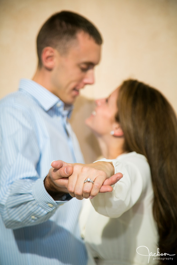 couple showing engagement rings