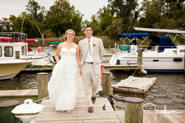 bride and groom walking on the pier